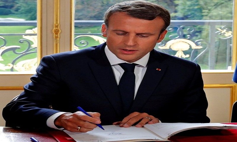 France's Macron signs labour reforms in law, defying protests