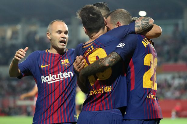 Own goals help Barcelona win 3-0 at Girona