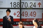 Asian shares mixed as investors mull weekend vote results