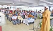 Participants offer munajat at a doa mahfil