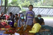 Evacuations from Indonesian volcano swell to nearly 50,000