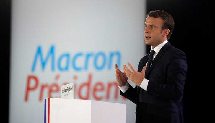 Macron urges EU-wide corporate tax band by 2020