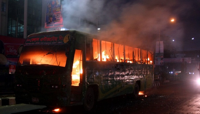 Bus torched after death in city road crash