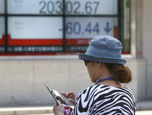 Asian shares slightly higher, though Japan is exception