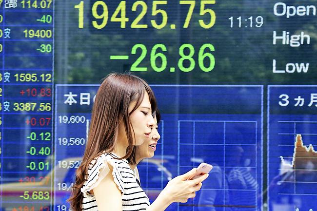 Tokyo stocks down at break as yen picks up