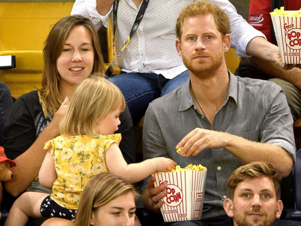 Prince Harry catches young girl 'stealing' his popcorn (Video)