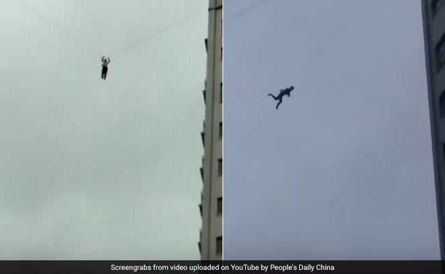 Man climbs onto telephone wire to avoid his hotel bill, gets stuck mid-air (Video)
