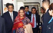 Prime Minister reaches London en route home