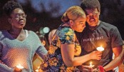 Candle-lit farewell for only Las Vegas cop killed in massacre