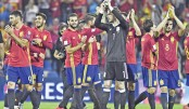 Spain seal World Cup spot,  Italy struggle in play-offs