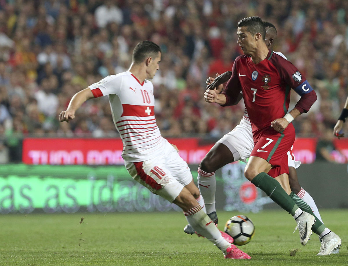 Portugal beats Switzerland 2-0 to earn World Cup berth