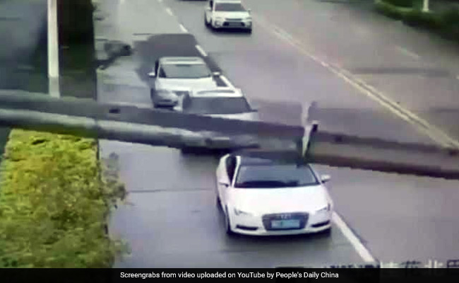 Crane crushes car, lucky driver climbs out of roof (Video)