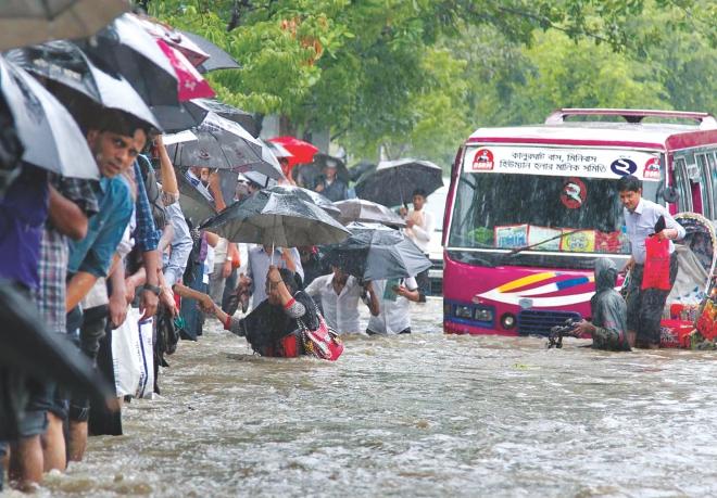Heavy rain disrupts life in Dhaka city