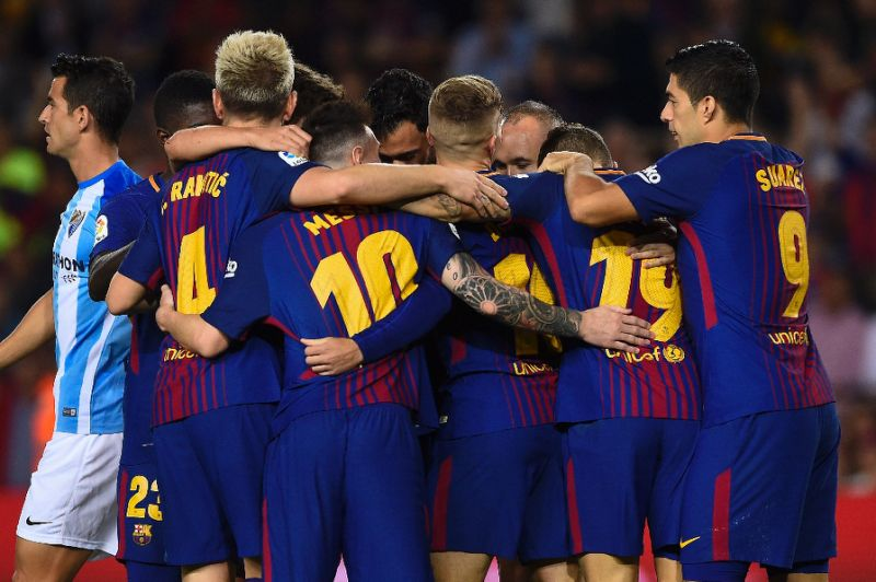 Barcelona holds off Malaga and regains cushion atop La Liga