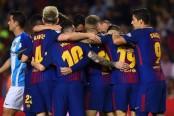 Barcelona holds off Malaga and regains cushion atop La Liga