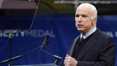 McCain takes swipe at Trump military service record