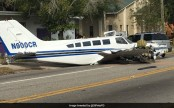 Small plane crashes on busy road, strikes two cars (Video)