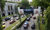 Singapore to freeze car numbers