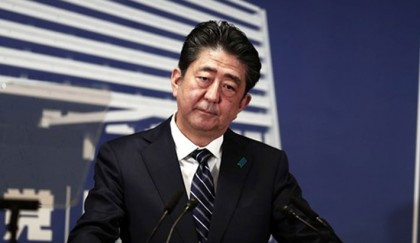 Abe aims at N Korea after storming to 'super-majority' vote win