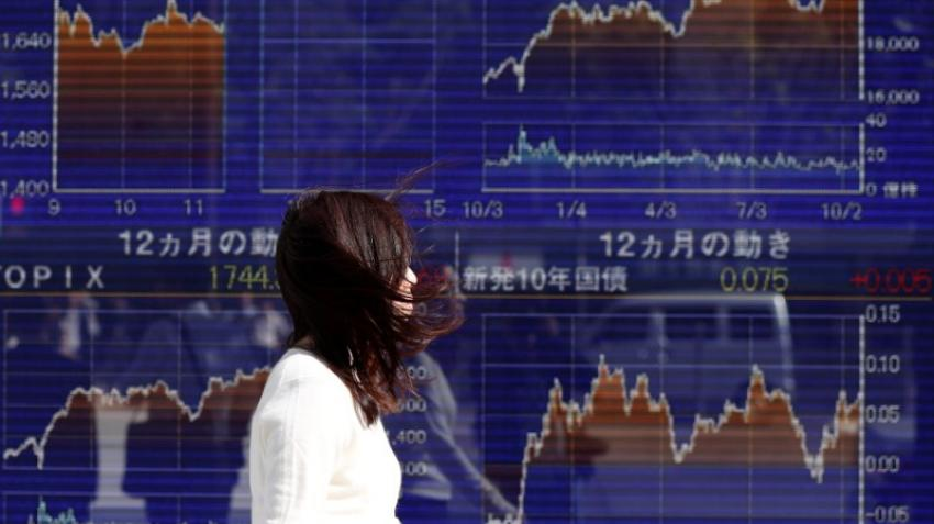 Asian markets muted ahead of earnings reports, Fed decision