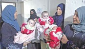 Syrian families wait to have their children examined by doctors
