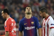 Barcelona held to goalless draw by Olympiacos
