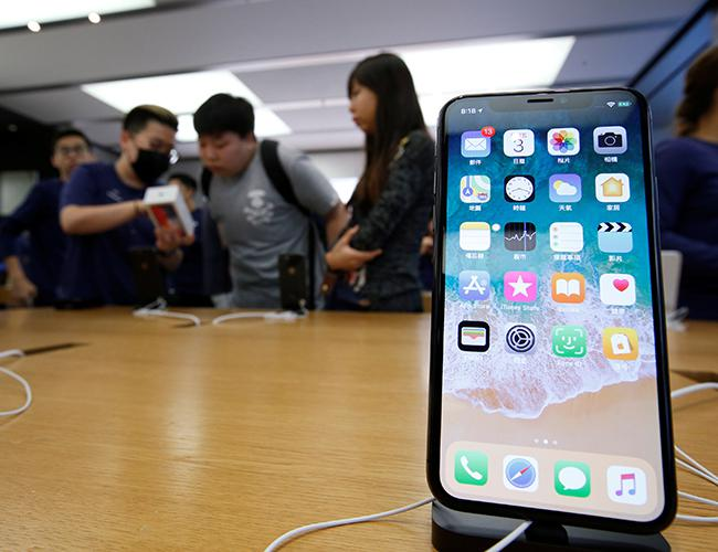 Apple's iPhone X hits Asia stores as profits soar