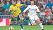 Real roll over Las Palmas to calm crisis talk