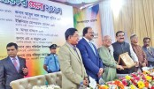 Finance Minister AMA Muhith hands over 'Kar Bahadur Paribar' award