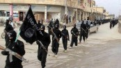 IS jihadists retake nearly half of Syria border town: monitor