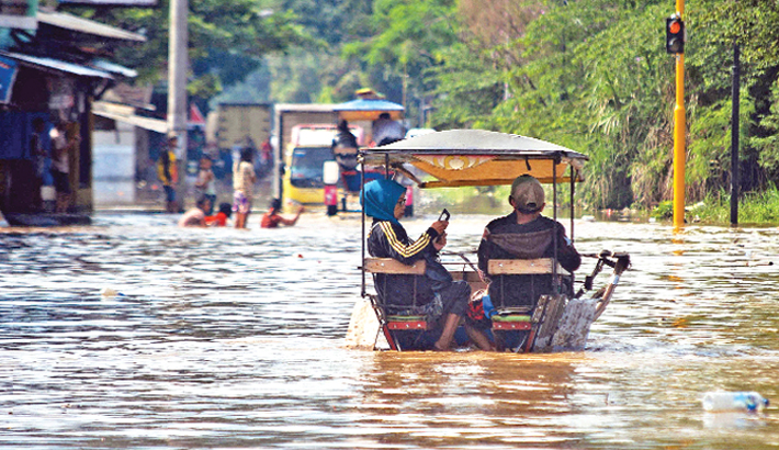 A flooded road in Bale Endah village in Bandung