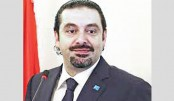 Hariri says he is 'free', will return to Lebanon soon