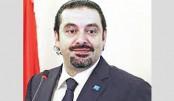 Hariri says he is 'free', will return to Lebanon soon