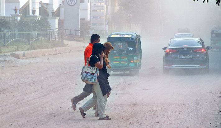 Pedestrians are covering their noses