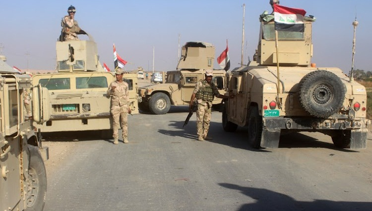 Iraq forces retake last town in country held by IS: army
