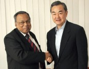 Chinese Foreign Minister sits with Bangladesh Foreign Minister