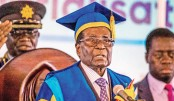 Mugabe makes defiant appearance after army takeover