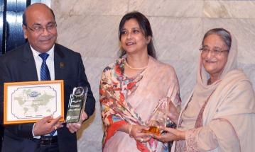 Prime Minister receives two awards won by Postal Department
