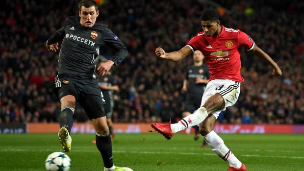United tops Champions League group with 2-1 win over CSKA