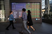 Asian markets dragged lower by tech, energy firms