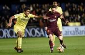 Suarez, Messi maintain Barca's La Liga lead