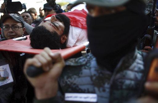 Israel to probe fatal shooting of Palestinian paraplegic