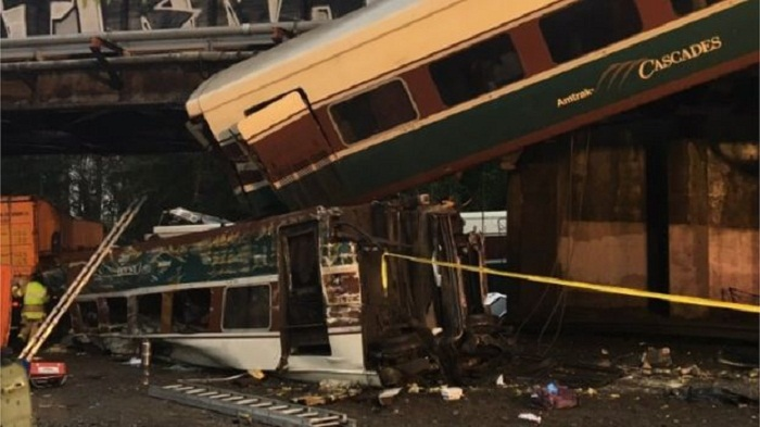 Deaths as rail carriages fall on US highway
