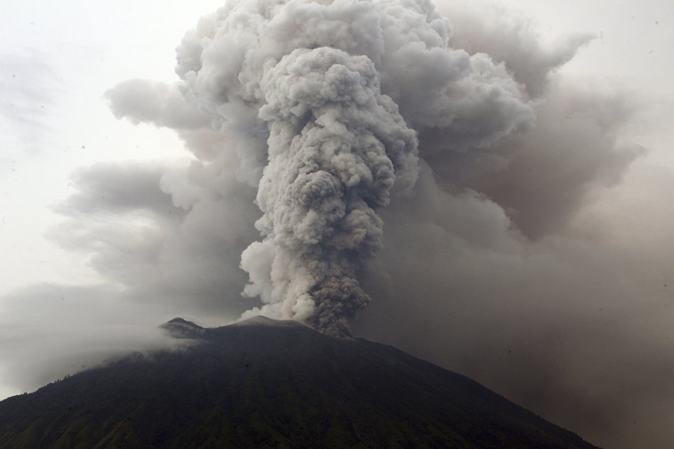 Indonesia's Bali volcano spews thick smoke, ashes