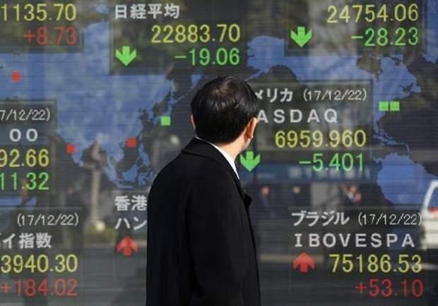 Tokyo stocks flat on tepid Christmas trading