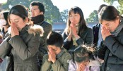 Worshippers pray during a New Year's Day