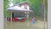 Two die, thousands  flee in storm-weary Philippines