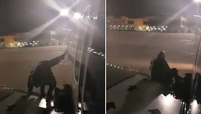 Tired of waiting, Ryanair passenger gets out and sits on wing
