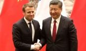 France signs deals with China but warns against 'pillaging'
