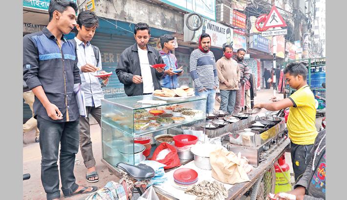 People throng a roadside shop